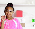 Young african american student girl displays confidence will excel sciences chemistry fields Royalty Free Stock Photo