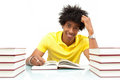 Young african american student reading books african people over white background Stock Photo