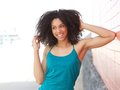 Young african american woman laughing outdoors Royalty Free Stock Photo