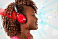 Young african american woman listening to music pretty with headphones glowing notes and lines concept Royalty Free Stock Image