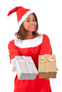 Young african american woman with santa hat and gifts isolated Stock Photos