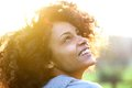Young african american woman smiling and looking up Royalty Free Stock Photo
