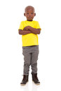 Young african boy adorable with arms crossed on white background Royalty Free Stock Photo