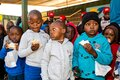 Young African Preschool kids eating sandwiches in the playground of a kindergarten school Royalty Free Stock Photo