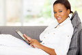 Young african tablet beautiful woman using computer at home Stock Photography