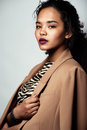 Young african woman in jacket with zebra print Royalty Free Stock Photo