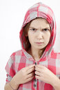 Young agressive little hoodie girl of eleven years old Stock Photos