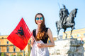 Young albanian patriot standing with flag in the center of tirana city albania Royalty Free Stock Photography