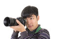 Young amateur photographer of asian hold a camera closeup portrait on white background Royalty Free Stock Photos
