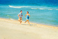 Young American Couple running, relaxing on the beach in New Jers Royalty Free Stock Photo