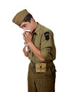 Young american soldier cold he has a handkerchief Royalty Free Stock Photography