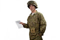 Young american soldier shows a letter in camouflage uniform Royalty Free Stock Photo