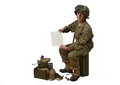 Young american soldier shows a letter in camouflage uniform Royalty Free Stock Photography