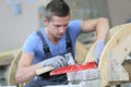 Young apprentice in masonry school Royalty Free Stock Photo