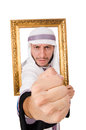 Young arab with picture frame on white Stock Images