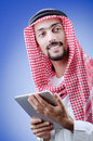 Young arab with tablet Royalty Free Stock Photos