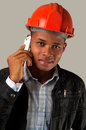 Young architect with cell phone african american engineer isolated Royalty Free Stock Image