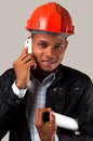 Young architect with cell phone african american engineer isolated Stock Photo