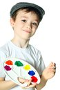 Young artist boy wearing a hat with paints on white background Royalty Free Stock Images
