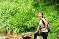 Young asain woman hiker hiking rainforest Royalty Free Stock Image