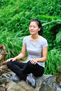 Young asain woman hiker sit rainforest Royalty Free Stock Photo