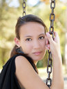 Young asian american woman sitting on swing Royalty Free Stock Photo