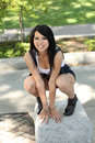 Young asian american woman squatting Stock Photo