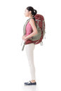 Young asian backpacker side view full length portrait isolated on white Stock Images