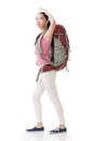 Young asian backpacker side view full length portrait isolated on white Royalty Free Stock Photos