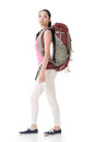 Young asian backpacker side view full length portrait isolated on white Royalty Free Stock Photography