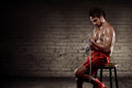 Young asian boxer man wearing white strap Royalty Free Stock Photo
