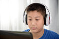 Young Asian boy using laptop technology at home. copyspace Royalty Free Stock Photo