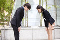 Young asian business executives bowing to each other culture Royalty Free Stock Photo