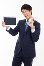 Young Asian business man showing a pad PC