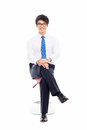 Young Asian business man sitting on the chair. Royalty Free Stock Photo