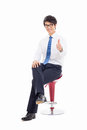 Young asian business man sitting on the chair and showing thumb isolated white background Royalty Free Stock Image