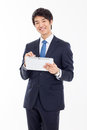 Young asian business man using a pad pc isolated on white background Stock Photos