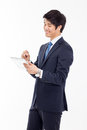 Young asian business man using a pad pc isolated on white background Stock Photography