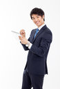 Young asian business man using a pad pc isolated on white background Royalty Free Stock Image