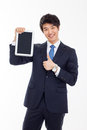 Young asian business man using a pad pc isolated on white background Stock Image