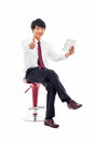 Young asian business man using pad pc sitting chair isolated white background Stock Images