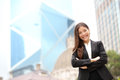 Young asian business people businesswoman portrait woman outside standing proud looking at camera in suit multiracial Royalty Free Stock Photo