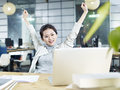 Young asian business woman celebrating in office Royalty Free Stock Photo