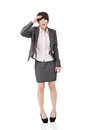 Young asian business woman is confused full length isolated on the white background Royalty Free Stock Photo