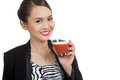 Young asian business woman drink tomato juice isolated on white background Royalty Free Stock Photography