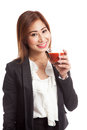 Young asian business woman drink tomato juice isolated on white background Stock Photography