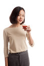Young asian business woman drink tomato juice isolated on white background Royalty Free Stock Photo
