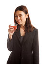 Young asian business woman drink tomato juice isolated on white background Stock Images
