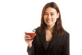 Young asian business woman drink tomato juice isolated on white background Royalty Free Stock Images