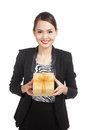 Young Asian business woman with a golden gift box Royalty Free Stock Photo